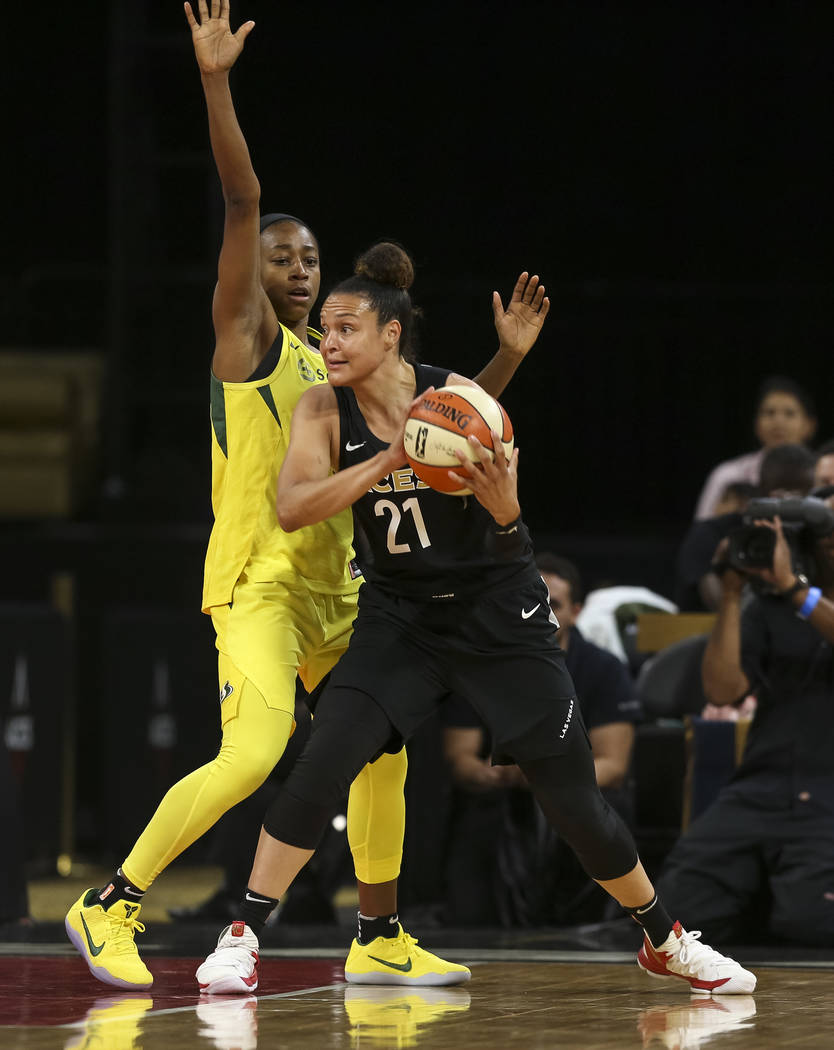 Las Vegas Aces guard Kayla McBride (21) looks for the pass as Seattle Storm guard Jewell Loyd (24) defends in the first half of a WNBA basketball game at the Mandalay Bay Events Center in Las Vega ...