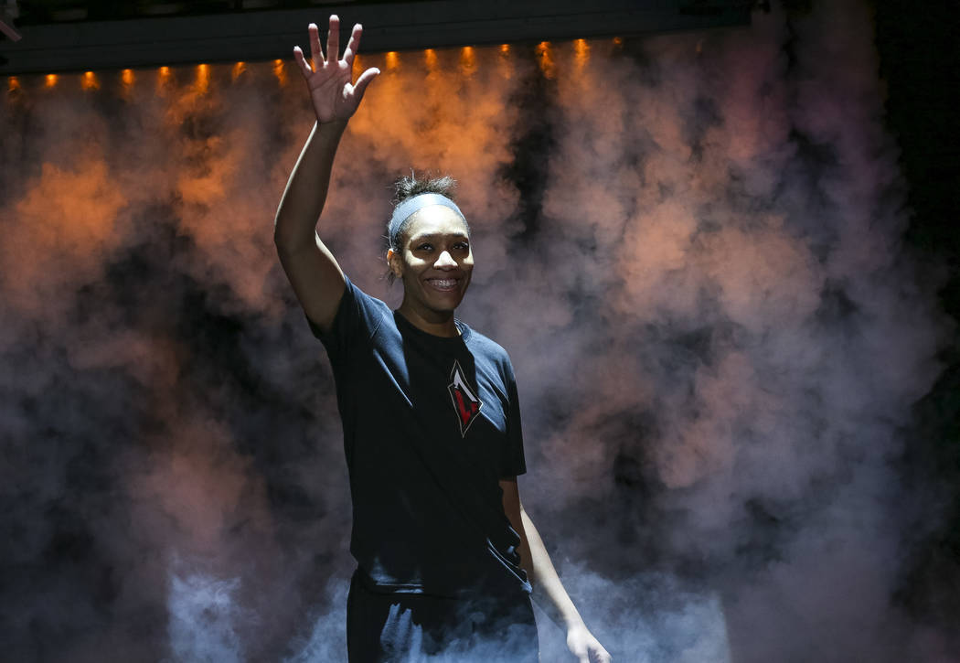 Las Vegas Aces center A'ja Wilson (22) is introduced to the crowd before playing the Seattle Storm in a WNBA basketball game at the Mandalay Bay Events Center in Las Vegas on Sunday, May 27, 2018. ...