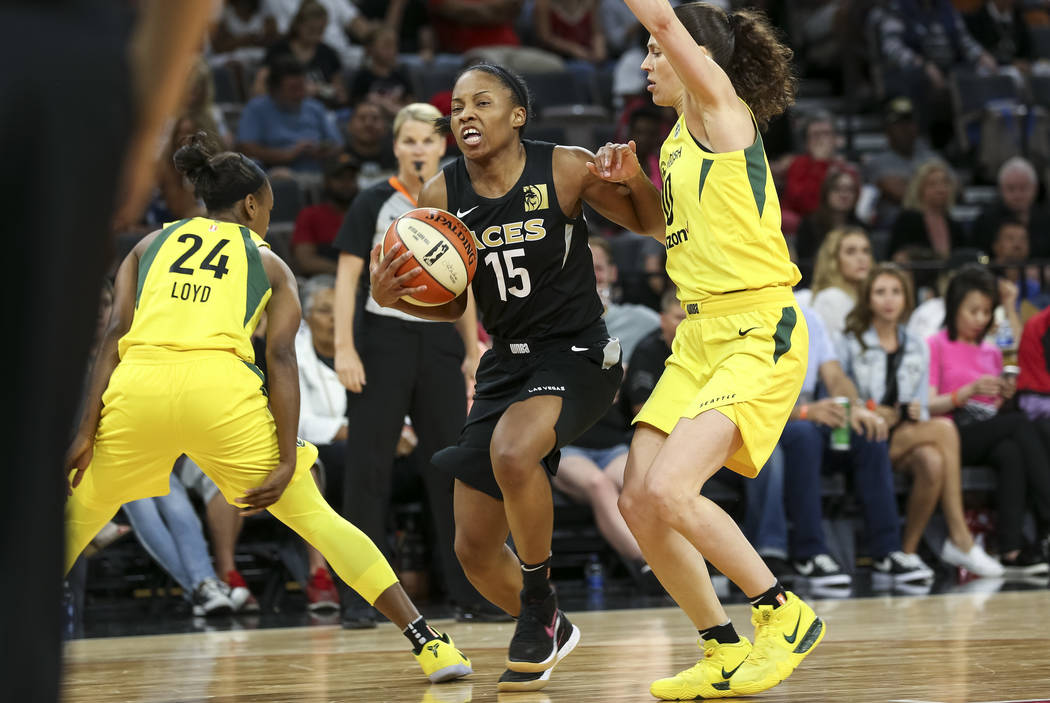 Las Vegas Aces guard Lindsay Allen (15) goes to the basket against Seattle Storm guard Sue Bird (10) in the second half of a WNBA basketball game at the Mandalay Bay Events Center in Las Vegas on ...