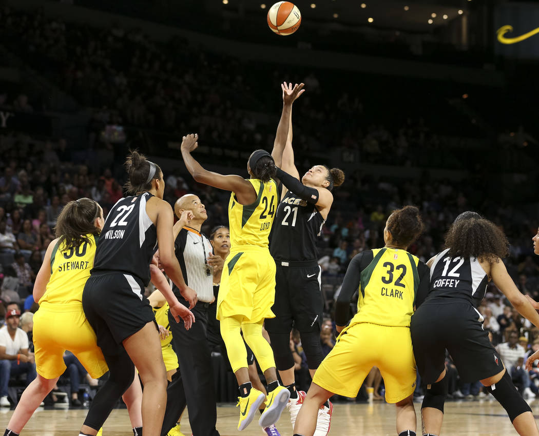 Seattle Storm guard Jewell Loyd (24) and Las Vegas Aces guard Kayla McBride (21) vie for a tip off in the second half of a WNBA basketball game at the Mandalay Bay Events Center in Las Vegas on Su ...