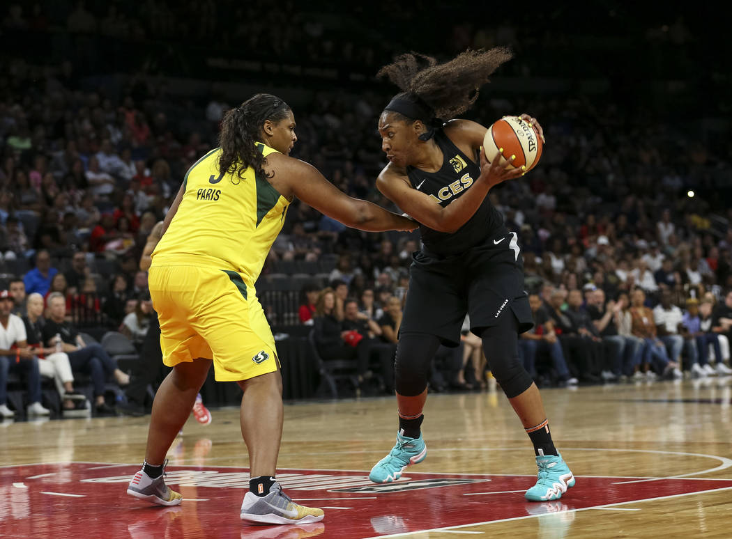 Seattle Storm center Courtney Paris (3) defends against Las Vegas Aces center Kelsey Bone (3) in the second half of a WNBA basketball game at the Mandalay Bay Events Center in Las Vegas on Sunday, ...