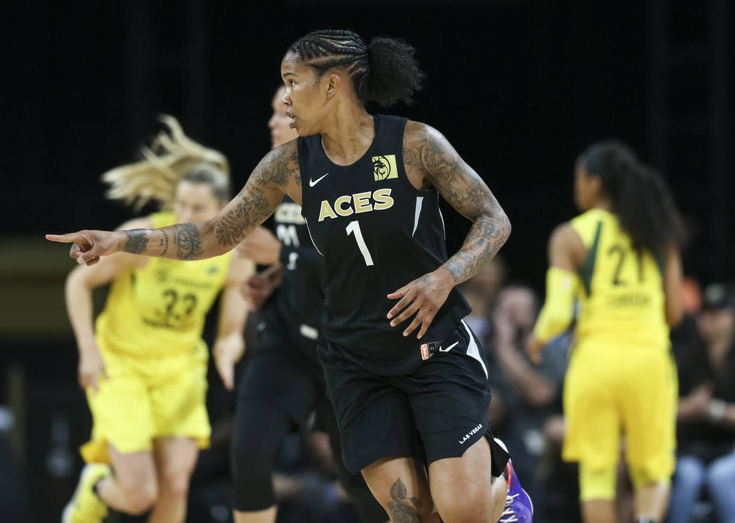 Las Vegas Aces forward Tamera Young (1) reacts after making a shot agains the Seattle Storm in the first half of a WNBA basketball game at the Mandalay Bay Events Center in Las Vegas on Sunday, Ma ...