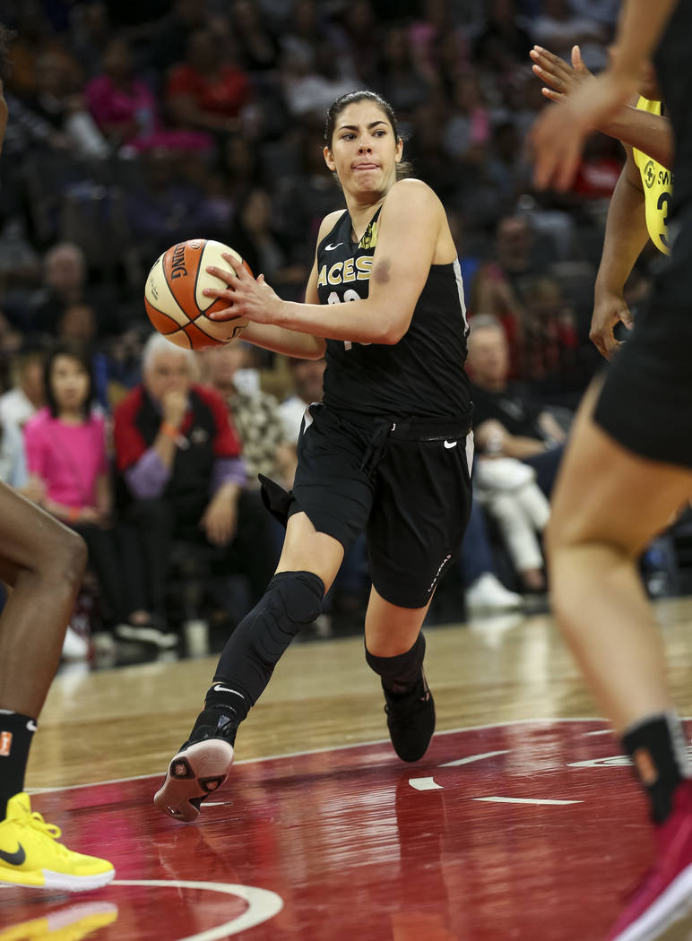 Las Vegas Aces guard Kelsey Plum (10) handles the ball against the Seattle Storm in the second half of a WNBA basketball game at the Mandalay Bay Events Center in Las Vegas on Sunday, May 27, 2018 ...