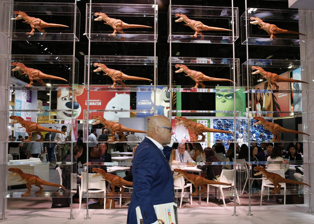 An expogoer walks past a display of dinosaurs at the 2018 Licensing Expo on Tuesday, May 22, 2018, in Las Vegas. Bizuayehu Tesfaye/Las Vegas Review-Journal @bizutesfaye