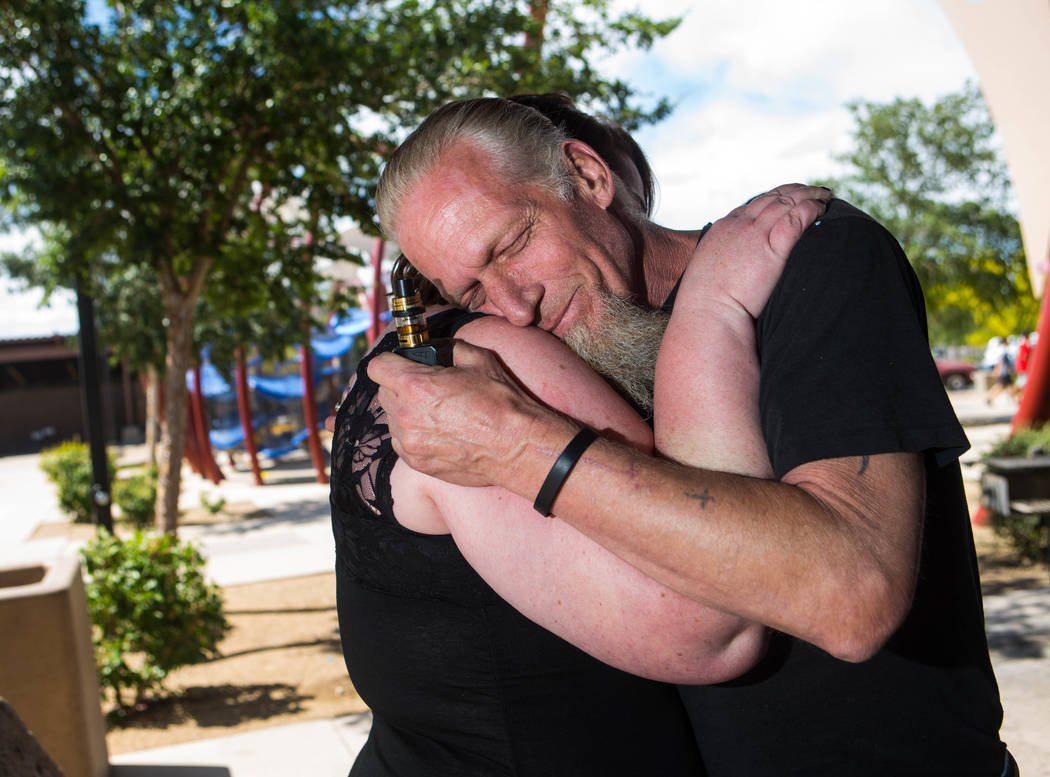 Michael Tubick, father of Melody Morgan, comforts Jamie, a friend, during a memorial for Morgan at Mountain's Edge park in Las Vegas on Saturday, May 26, 2018. Morgan died by suicide in April at t ...