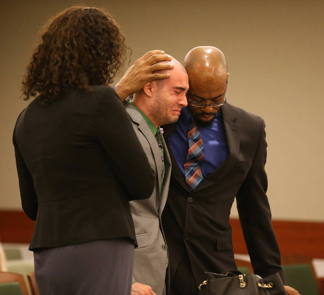 Former Las Vegas police Explorer Joshua Honea, center, reacts with his attorneys Monique McNeill and Jonathan MacArthur to being allowed to remain free on bail pending appeal after being sentenced ...