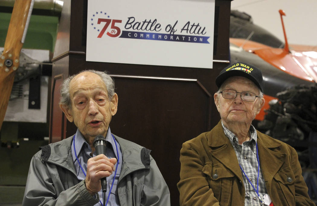 In this May 19, 2018, photo World War II veterans Allan Seroll, left, of Massachusetts, and William Roy Dover, right, of Alabama, right, attend a 75th anniversary celebration of the Battle of Attu ...