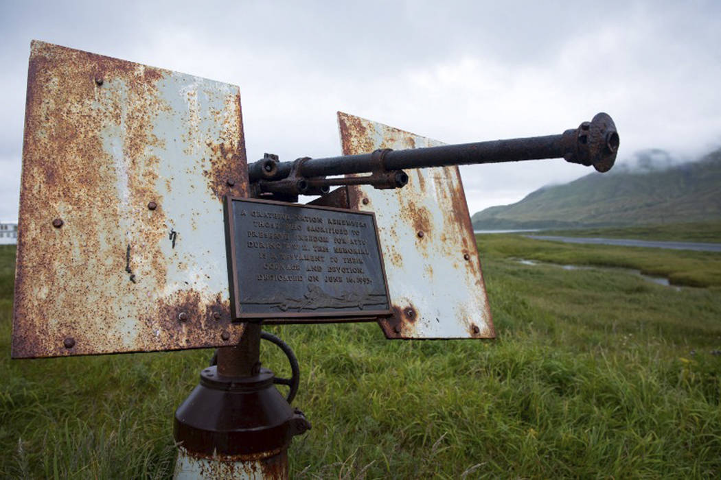 In this Aug. 22, 2017 photo provided by the U.S. Fish and Wildlife Service, an artillery monument sits above Massacre Bay on Attu Island, Alaska. One of the bloodiest World War II battles in the P ...