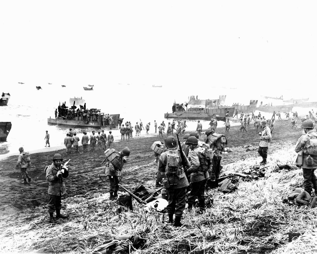 FILE - In this May 26, 1943 file photo released by the U.S. Navy, American soldiers and equipment land on the black volcanic beach during World War II at Massacre Bay on Attu Island, part of the A ...