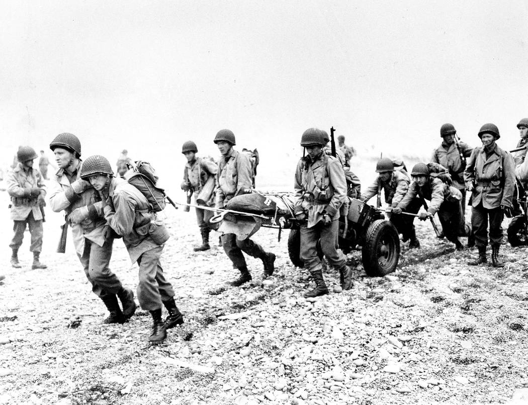 FILE - In this June 23, 1943 file photo, U.S. Army reinforcements land on a beach during World War II on Attu Island, part of the Aleutian Islands of Alaska. May 30, 2018 will mark the 75th annive ...