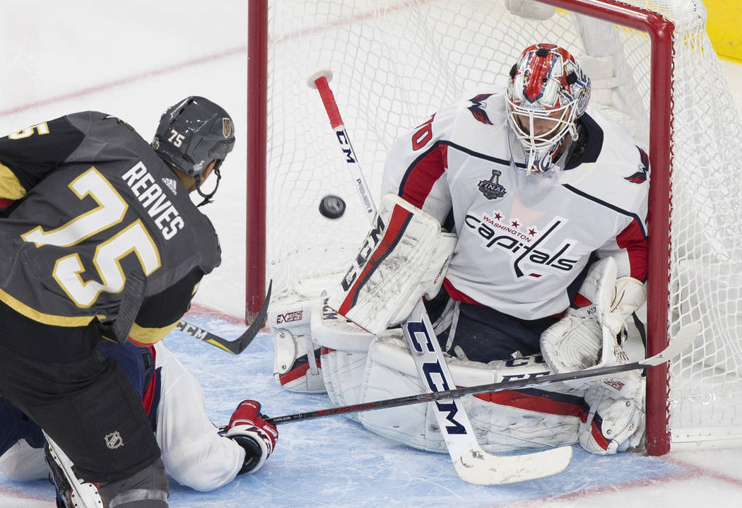 Golden Knights right wing Ryan Reaves (75) scores a third-period goal against Capitals goaltender Braden Holtby (70) during Game 1 of the NHL Stanley Cup Finals on Monday, May 28, 2018, at T-Mobil ...