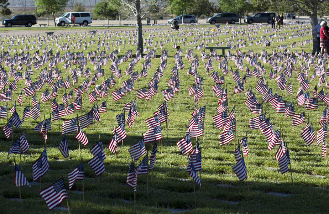 Flags placed at gravesites at the Southern Nevada Veterans Memorial Cemetery in Boulder City on Saturday, May 26, 2018. (Richard Brian/Las Vegas Review-Journal) @vegasphotograph