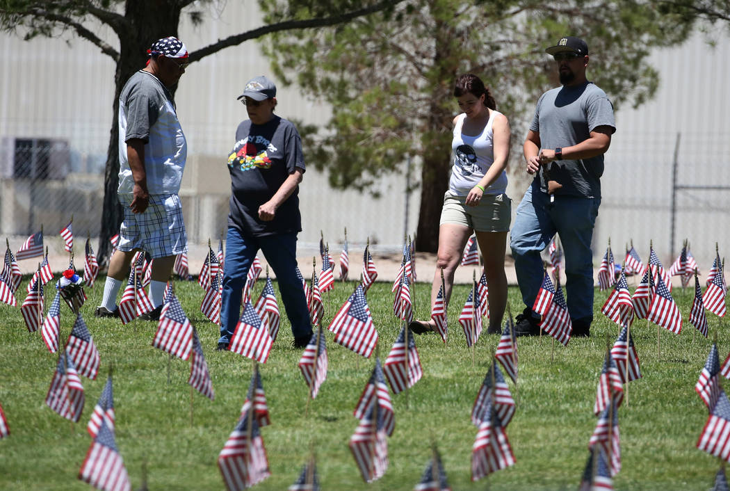 People visit the Southern Nevada Veterans Memorial Cemetery on Memorial Day on Monday, May 28, 2018, in Boulder City. Bizuayehu Tesfaye/Las Vegas Review-Journal @bizutesfaye