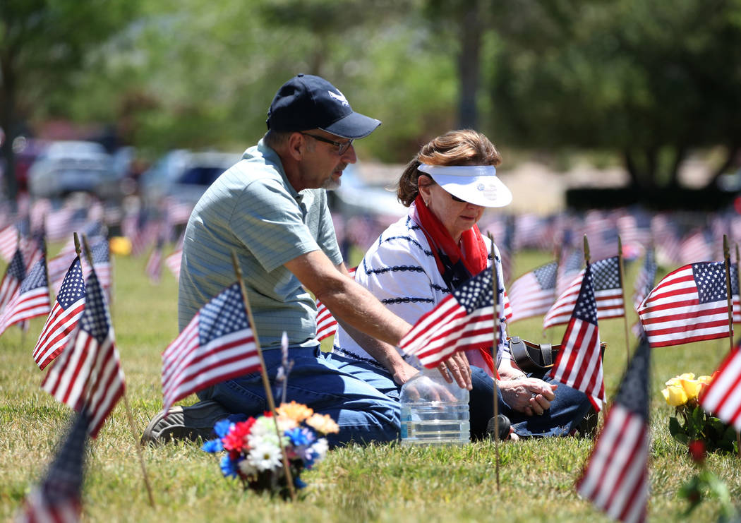 Lynne Folak visits her parents' grave with her husband Alan on Memorial Day at the Southern Nevada Veterans Memorial Cemetery on Monday, May 28, 2018, in Boulder City. Folaks' father served in the ...