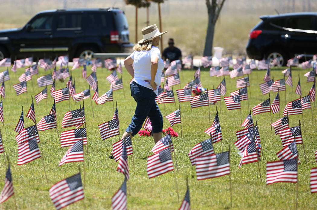 A woman, who declined to give her name, visits the Southern Nevada Veterans Memorial Cemetery on Monday, May 28, 2018, in Boulder City. Bizuayehu Tesfaye/Las Vegas Review-Journal @bizutesfaye
