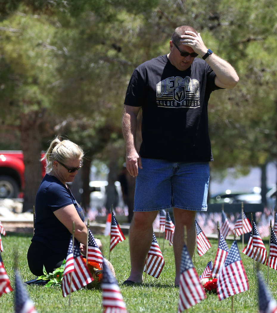 Gus Chaltas visits his parents' grave with his wife Jennifer on Memorial Day at the Southern Nevada Veterans Memorial Cemetery on Monday, May 28, 2018, in Boulder City. Charltas' father, Sam Gust ...