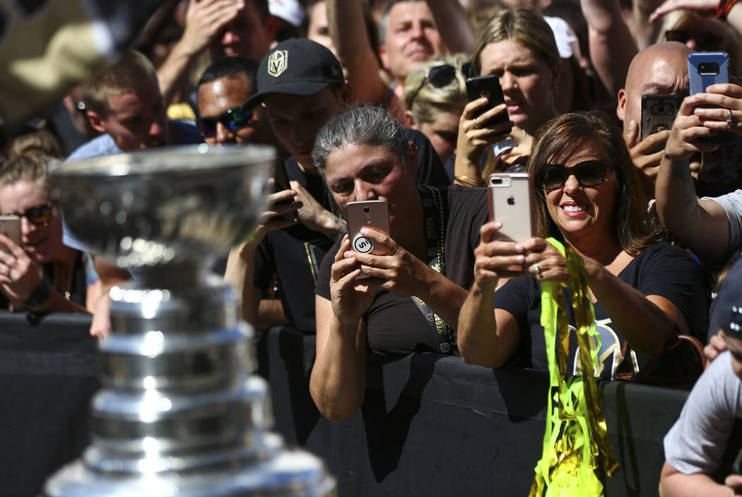 Golden Knights fans take pictures of the Stanley Cup after a concert ahead of Game 1 of the NHL hockey Stanley Cup Final at the T-Mobile Arena in Las Vegas on Monday, May 28, 2018. Chase Stevens L ...