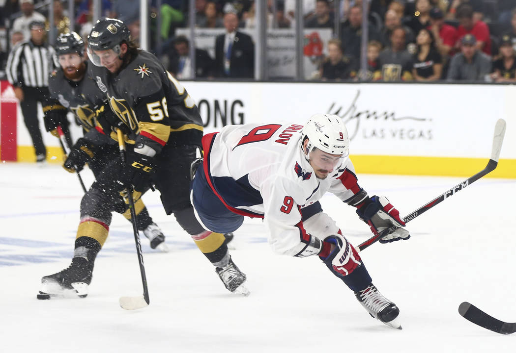 Washington Capitals defenseman Dmitry Orlov (9) trips up after losing the puck to Golden Knights left wing Erik Haula (56) during the second period of Game 1 of the NHL hockey Stanley Cup Final at ...