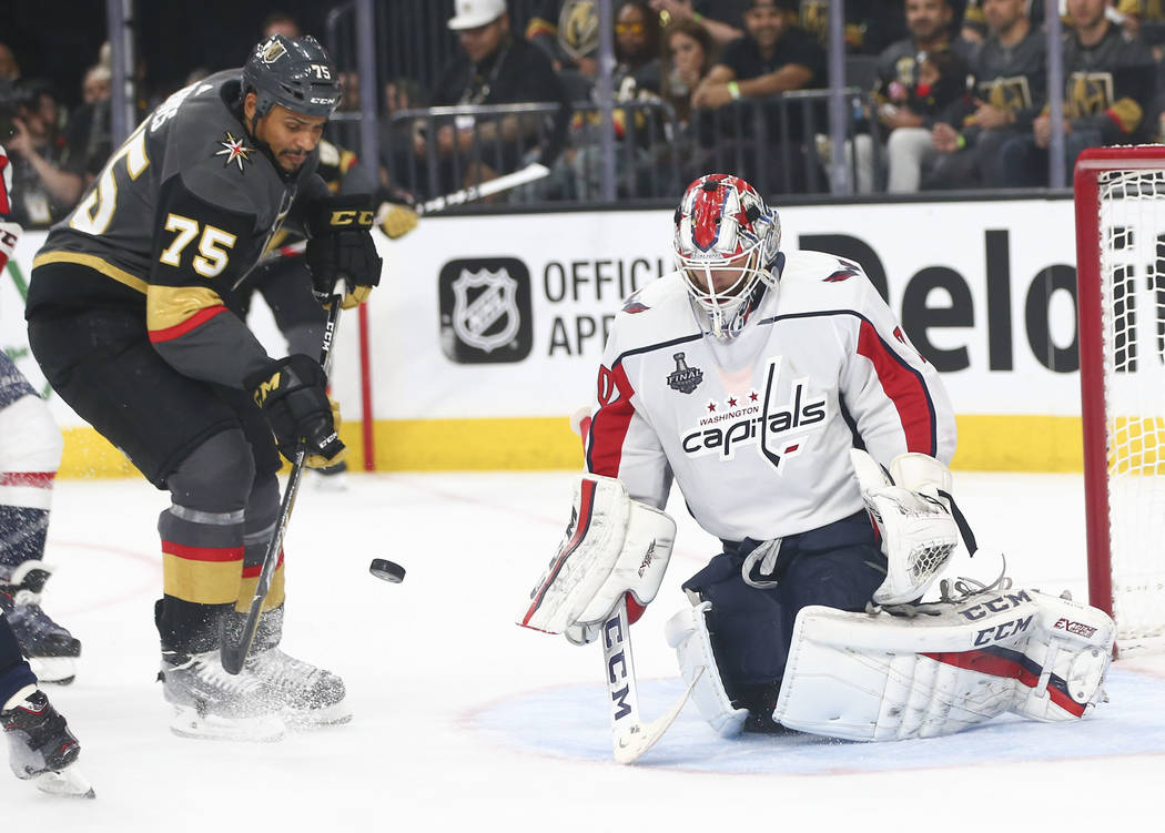 Washington Capitals goaltender Braden Holtby (70) blocks a shot from the Golden Knights as right wing Ryan Reaves (75) looks on during the third period of Game 1 of the NHL hockey Stanley Cup Fina ...