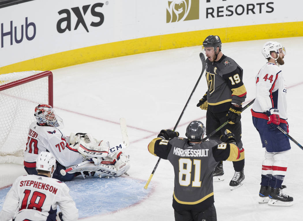 Golden Knights right wing Reilly Smith (19) celebrates with center Jonathan Marchessault (81) after scoring a second-period goal against Capitals goaltender Braden Holtby (70) during Game 1 of the ...