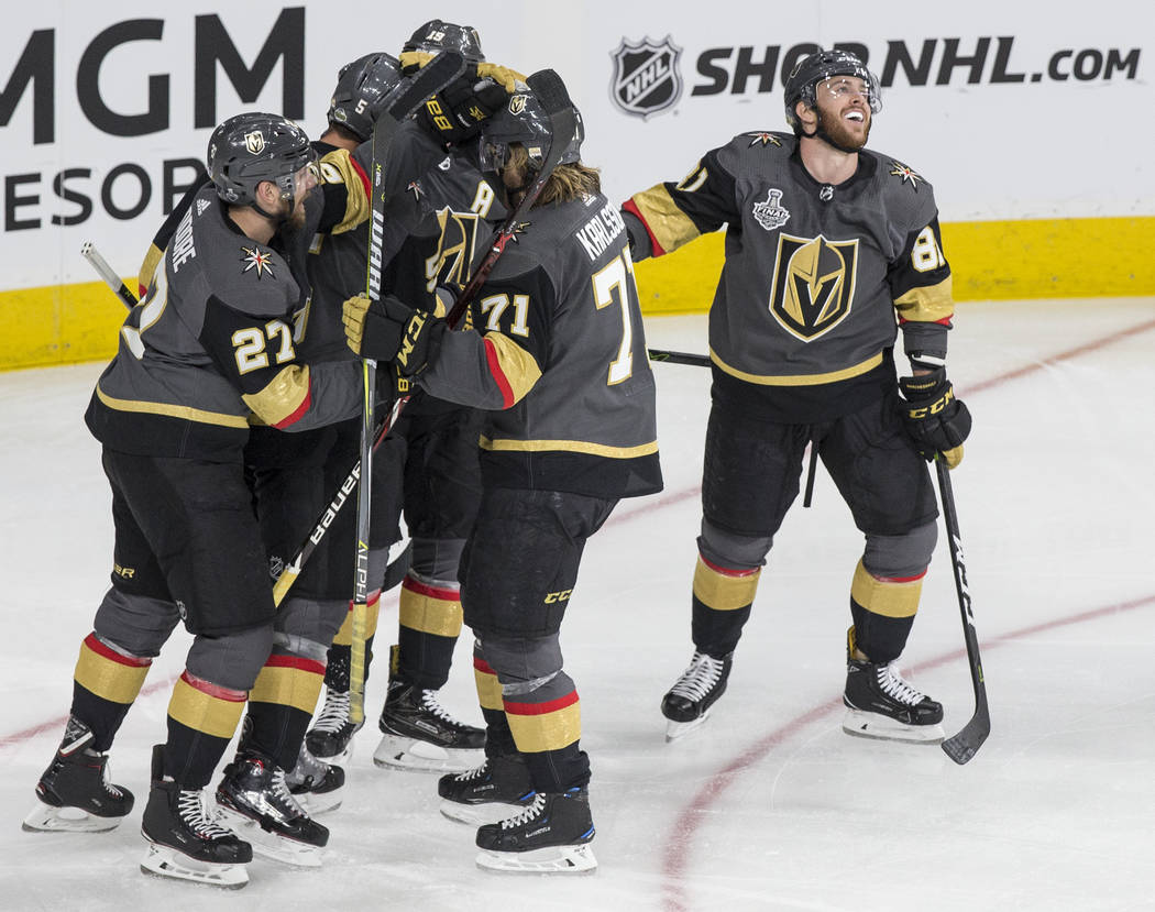 Golden Knights right wing Reilly Smith (19) celebrates with teammates Jonathan Marchessault (81), Deryk Engelland (5), Shea Theodore (27) and William Karlsson (71) after scoring a second-period go ...