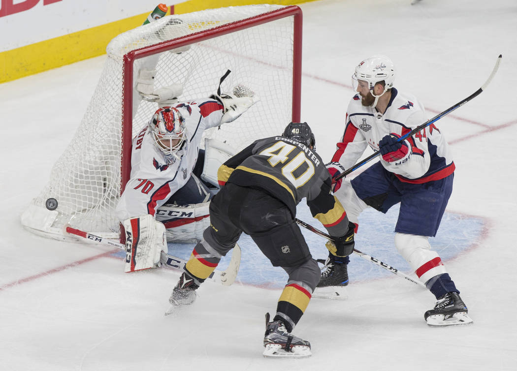 Capitals goaltender Braden Holtby (70) makes a second-period save against Golden Knights center Ryan Carpenter (40) during Game 1 of the NHL Stanley Cup Finals on Monday, May 28, 2018, at T-Mobile ...
