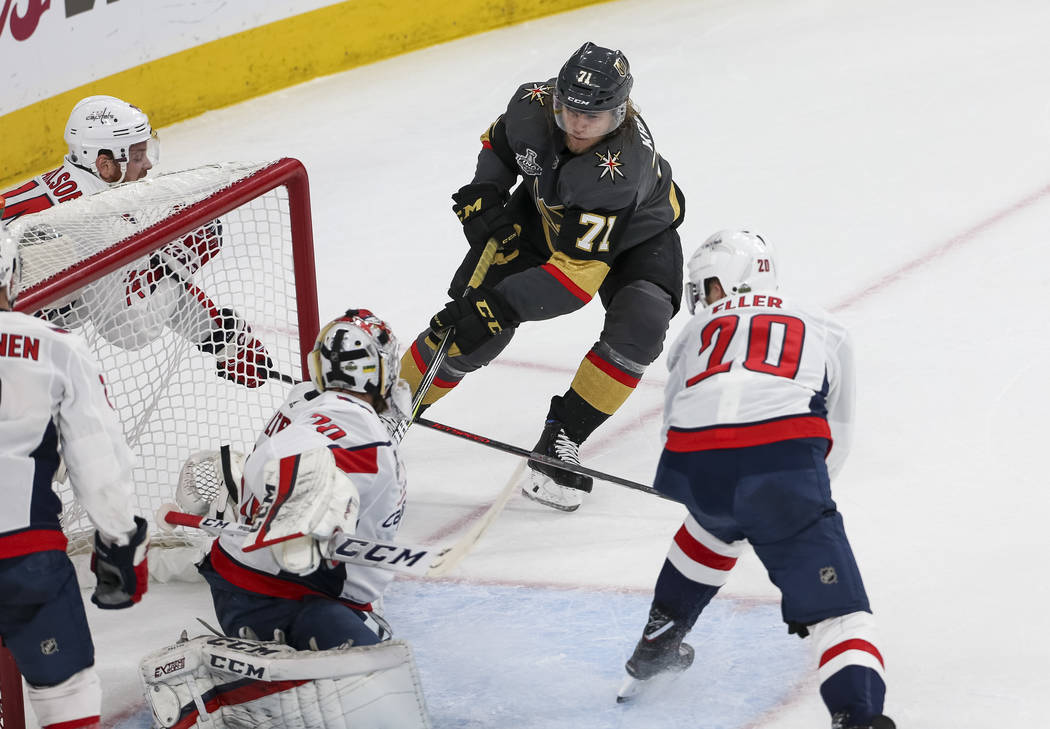 Vegas Golden Knights center William Karlsson (71) gets the puck past Washington Capitals goaltender Braden Holtby (70) for a goal during the first period in Game 1 of the NHL hockey Stanley Cup Fi ...