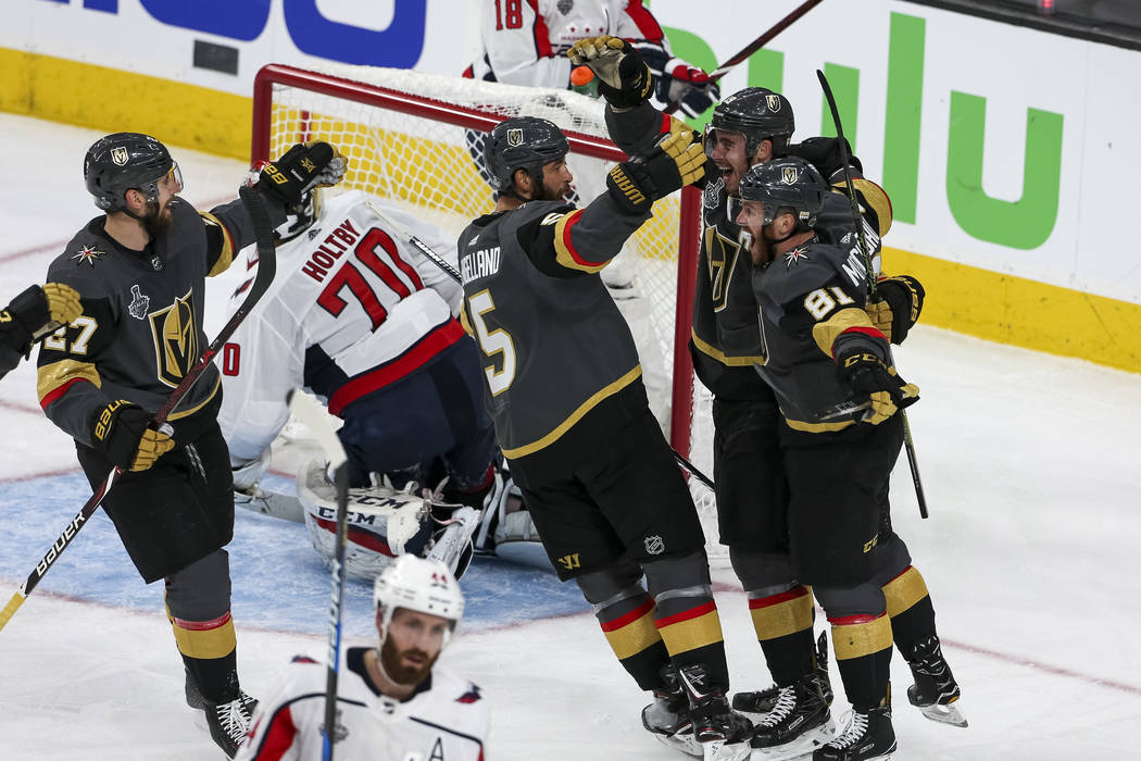 The Vegas Golden Knights celebrate a second period goal by right wing Reilly Smith (19) during the second period in Game 1 of the NHL hockey Stanley Cup Finals between the Golden Knights and the W ...