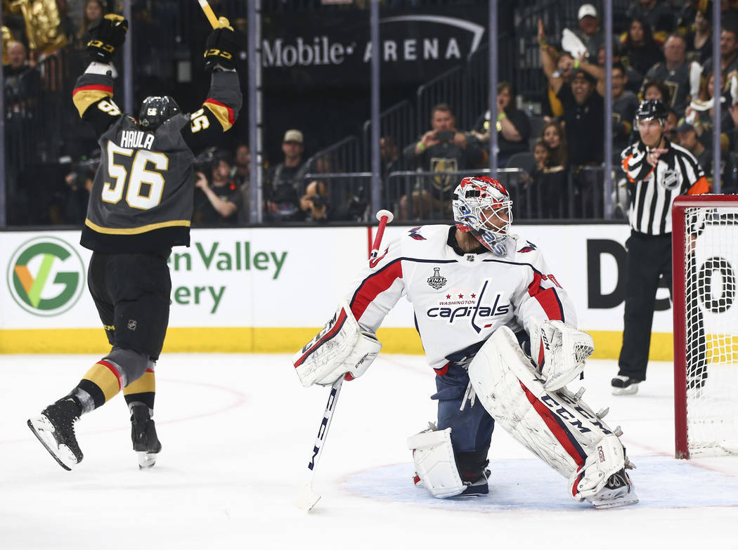 Golden Knights left wing Erik Haula (56) celebrates a goal by defenseman Colin Miller, not pictured, against Washington Capitals goaltender Braden Holtby (70) during the first period of Game 1 of ...