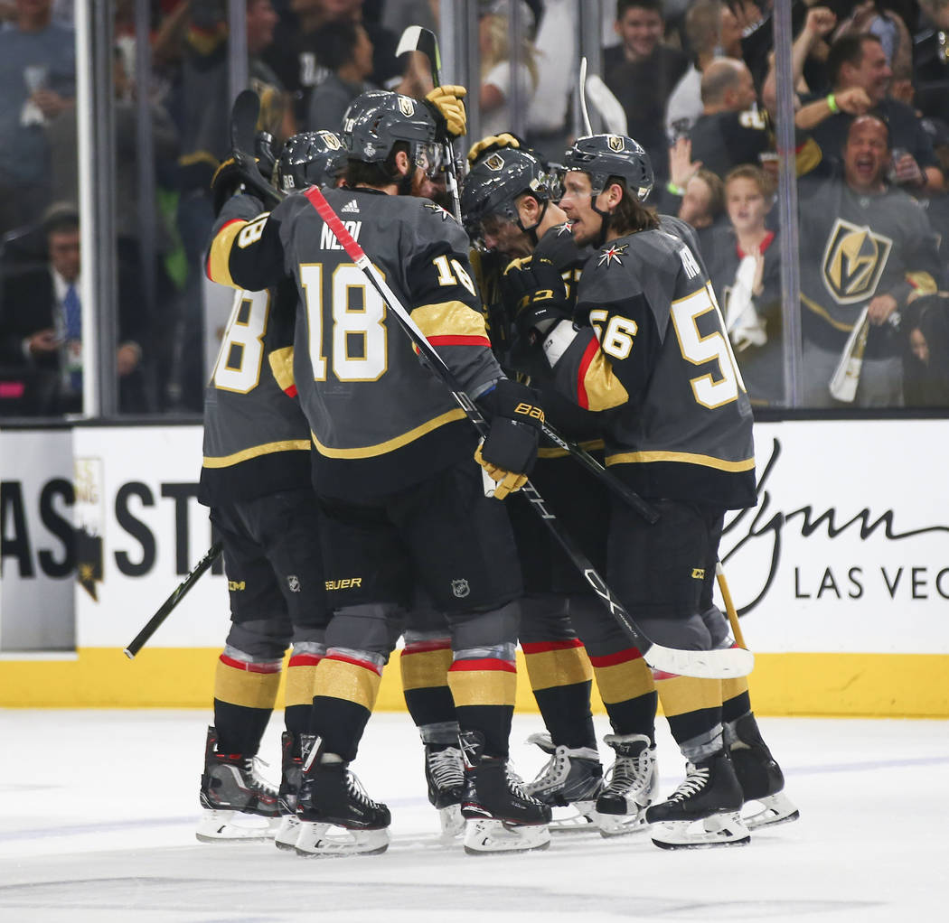 Golden Knights players celebrate a goal by Golden Knights defenseman Colin Miller against the Washington Capitals during the first period of Game 1 of the NHL hockey Stanley Cup Final at the T-Mob ...