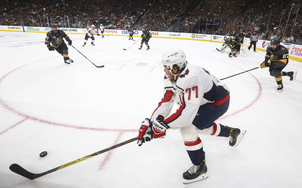 Washington Capitals right wing T.J. Oshie (77) moves the puck against the Golden Knights during the second period of Game 1 of the NHL hockey Stanley Cup Final at the T-Mobile Arena in Las Vegas o ...