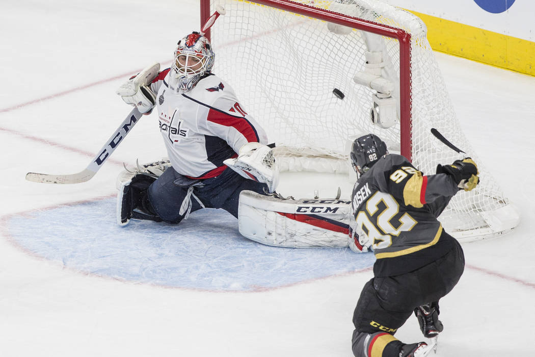 Golden Knights center Tomas Nosek (92) scores a third-period goal against Capitals goaltender Braden Holtby (70) during Game 1 of the NHL Stanley Cup Finals on Monday, May 28, 2018, at T-Mobile Ar ...