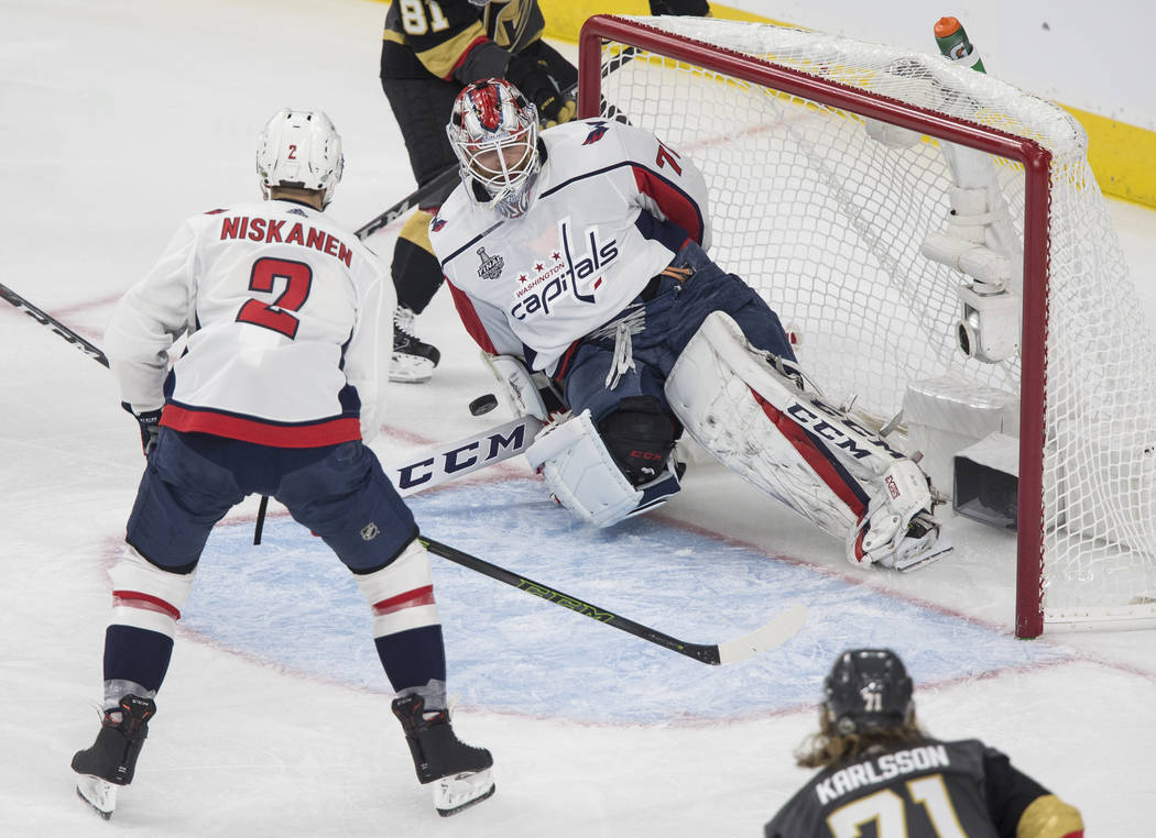 Capitals goaltender Braden Holtby (70) makes a first-period save during Game 1 of the NHL Stanley Cup Finals against the Golden Knights on Monday, May 28, 2018, at T-Mobile Arena, in Las Vegas. Be ...