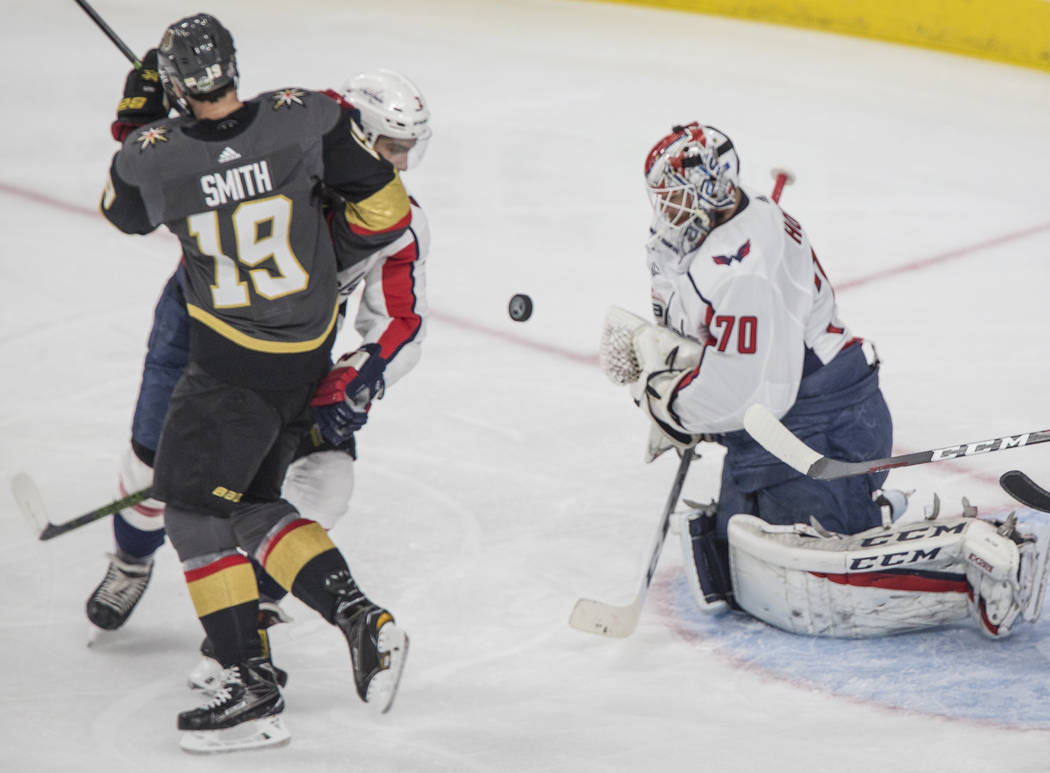 Capitals goaltender Braden Holtby (70) makes a first-period save against Golden Knights right wing Reilly Smith (19) during Game 1 of the NHL Stanley Cup Finals on Monday, May 28, 2018, at T-Mobil ...