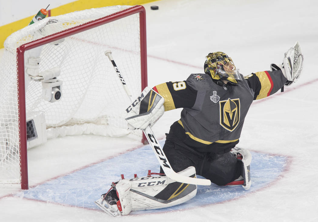 Golden Knights goaltender Marc-Andre Fleury (29) makes a save in the first period during Vegas' Game 1 matchup with the Washington Capitals during the NHL Stanley Cup Finals on Monday, May 28, 201 ...