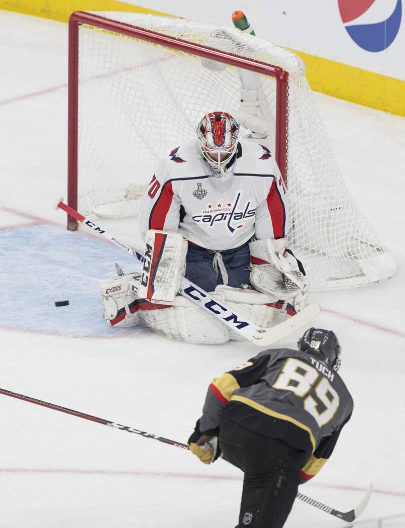 Golden Knights right wing Alex Tuch (89) shoots on Capitals goaltender Braden Holtby (70) in the first period of Game 1 of the NHL Stanley Cup Finals on Monday, May 28, 2018, at T-Mobile Arena, in ...
