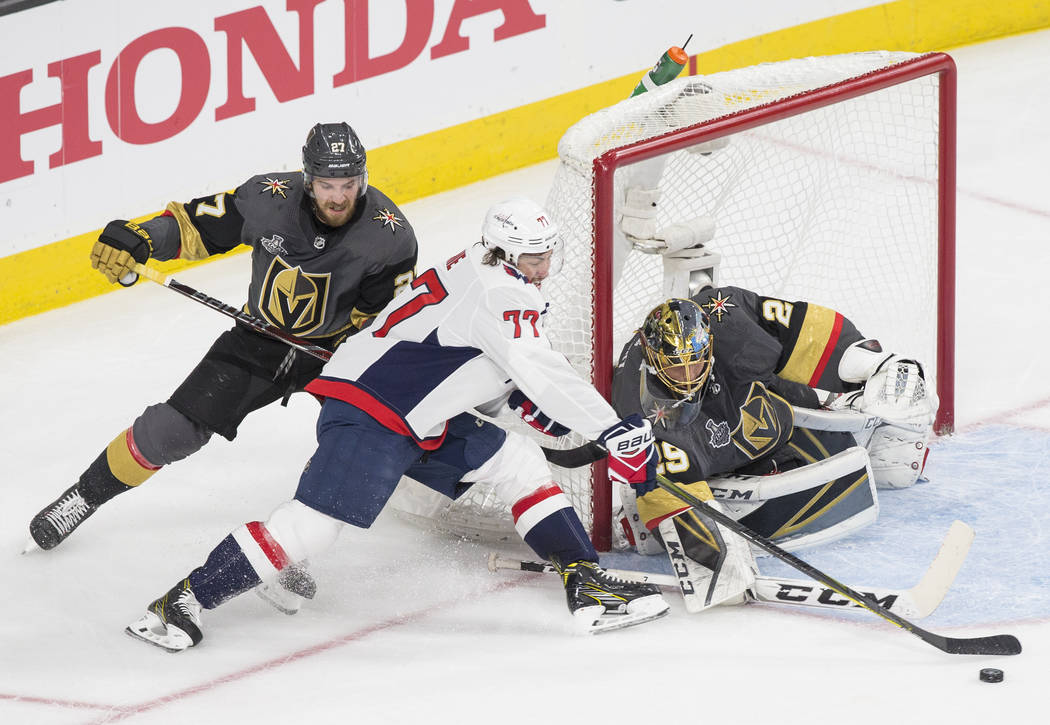 Golden Knights goaltender Marc-Andre Fleury (29) makes a save against Capitals right wing T.J. Oshie (77) in the first period during Vegas' Game 1 matchup with the Washington Capitals during the N ...