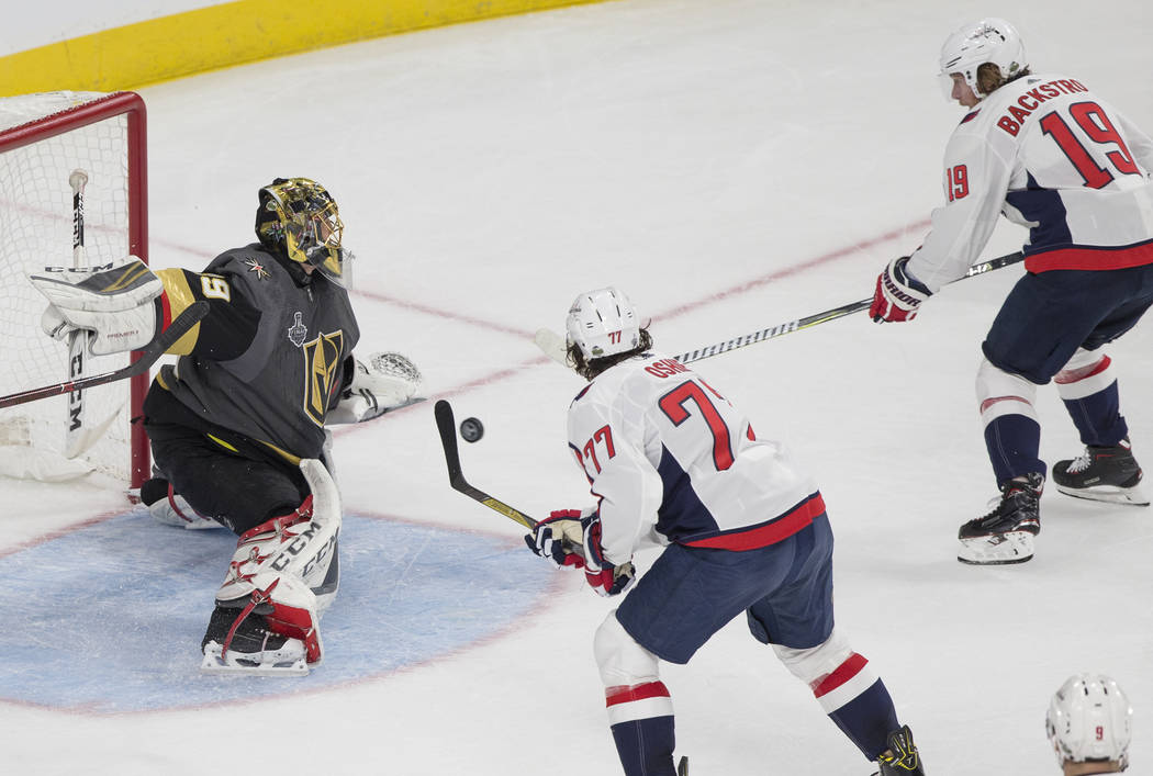 Golden Knights goaltender Marc-Andre Fleury (29) gives up a first-period goal to Capitals center Nicklas Backstrom (19) during Game 1 of the NHL Stanley Cup Finals on Monday, May 28, 2018, at T-Mo ...
