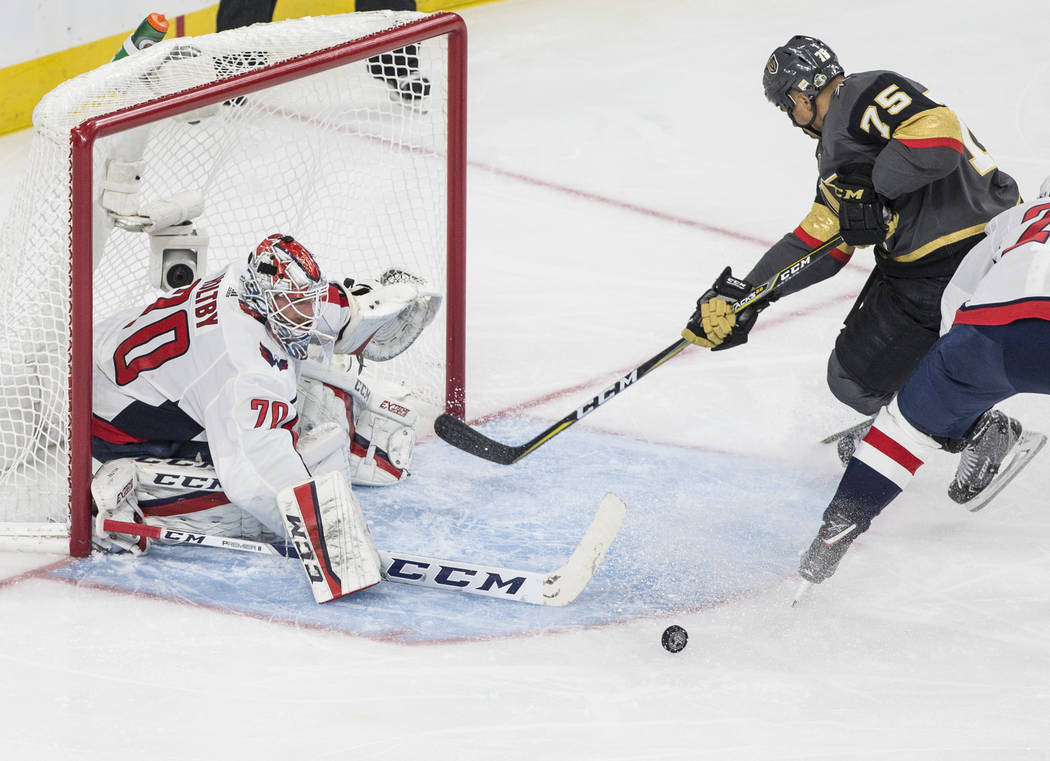Capitals goaltender Braden Holtby (70) makes a second-period save against Golden Knights right wing Ryan Reaves (75) during Game 1 of the NHL Stanley Cup Finals on Monday, May 28, 2018, at T-Mobil ...