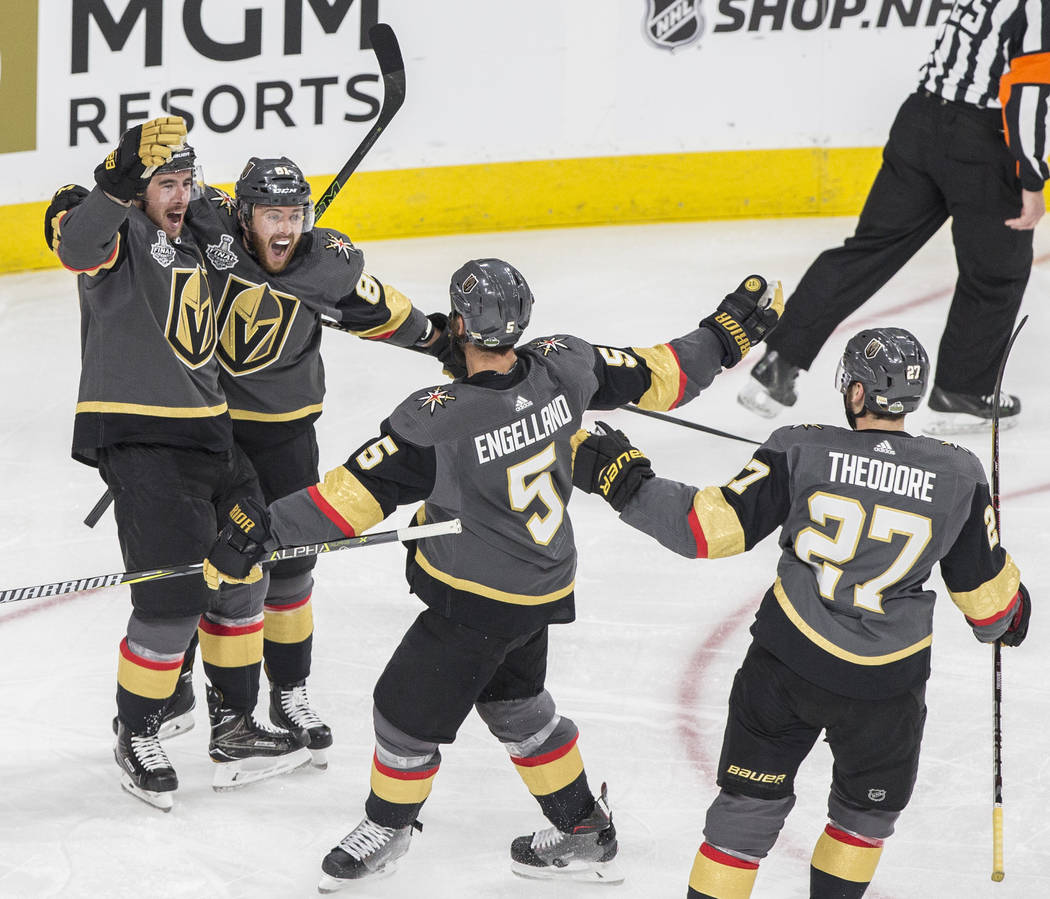 Golden Knights right wing Reilly Smith (19) celebrates with teammates Jonathan Marchessault (81), Deryk Engelland (5) and Shea Theodore (27) after scoring a second-period goal during Game 1 of th ...