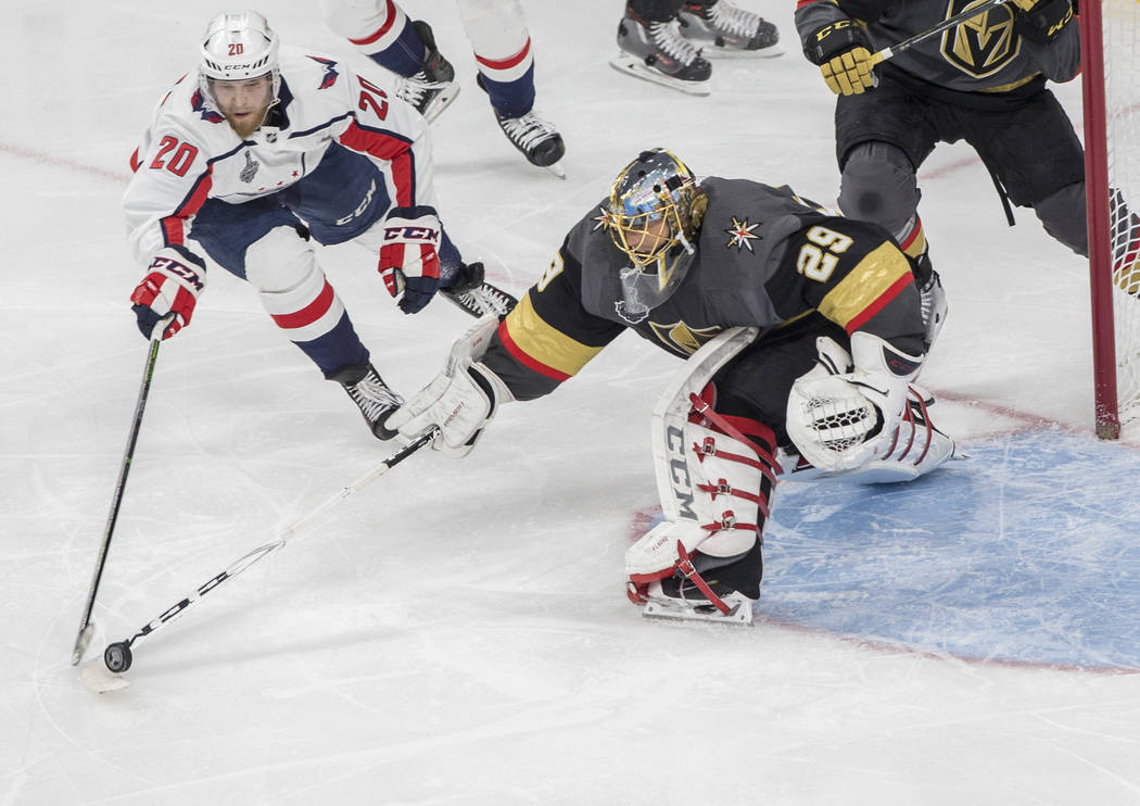 Golden Knights goaltender Marc-Andre Fleury (29) makes a second-period save against Capitals center Lars Eller (20) during Vegas' Game 1 matchup with the Washington Capitals during the NHL Stanley ...