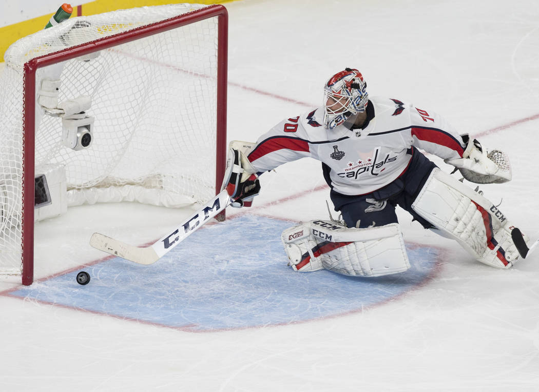 Capitals goaltender Braden Holtby (70) makes a second-period save during Game 1 of the NHL Stanley Cup Finals against the Golden Knights on Monday, May 28, 2018, at T-Mobile Arena, in Las Vegas. B ...