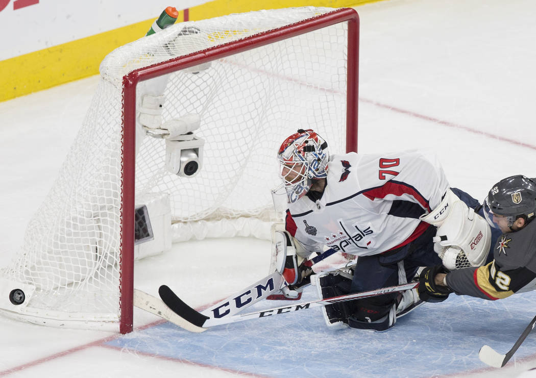 Capitals goaltender Braden Holtby (70) makes a second-period save against Golden Knights center Tomas Nosek (92) during Game 1 of the NHL Stanley Cup Finals on Monday, May 28, 2018, at T-Mobile Ar ...