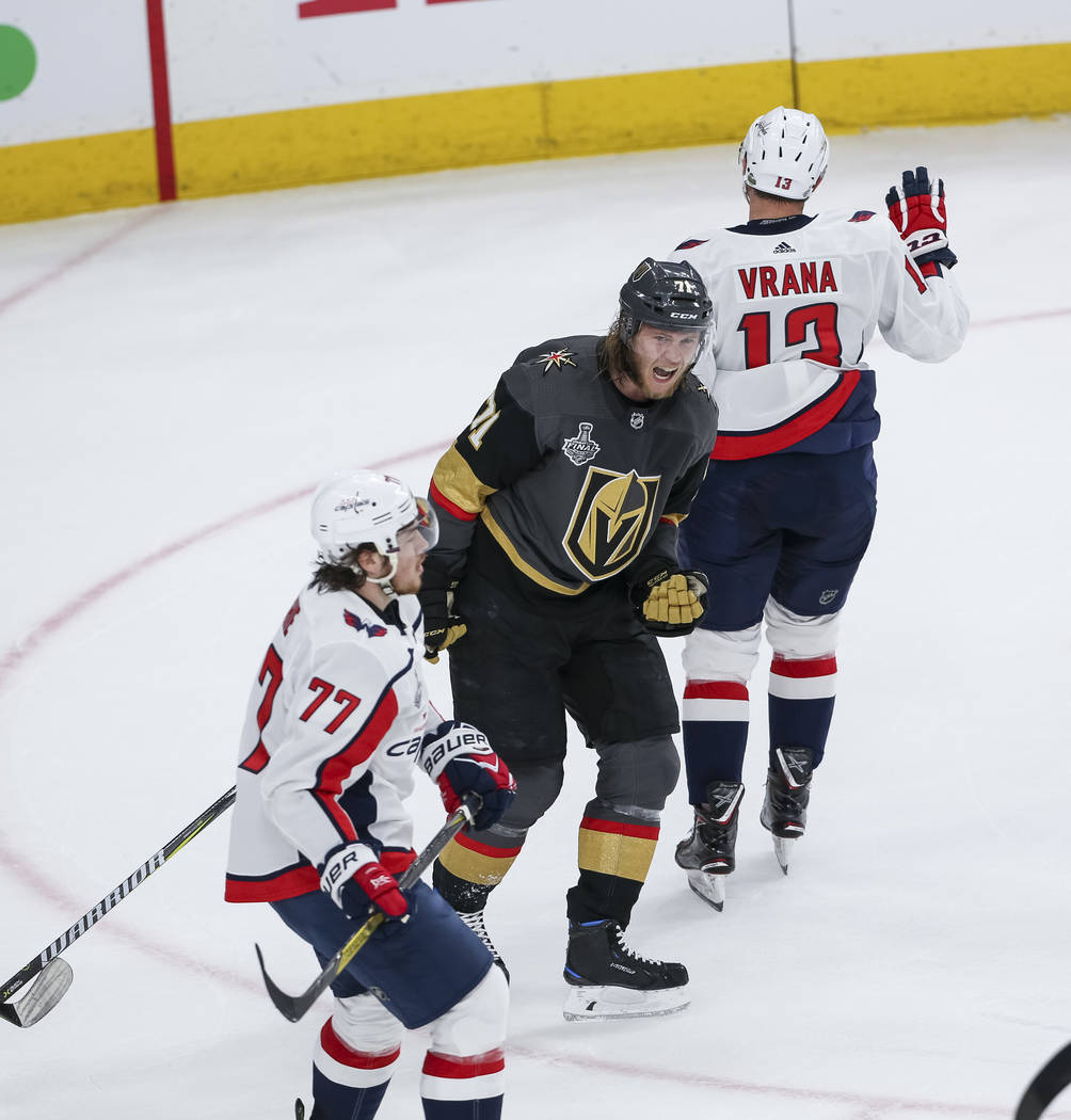 Vegas Golden Knights center William Karlsson (71) celebrates his first period goal as Washington Capitals right wing T.J. Oshie (77) and left wing Jakub Vrana (13) skate away in Game 1 of the NHL ...