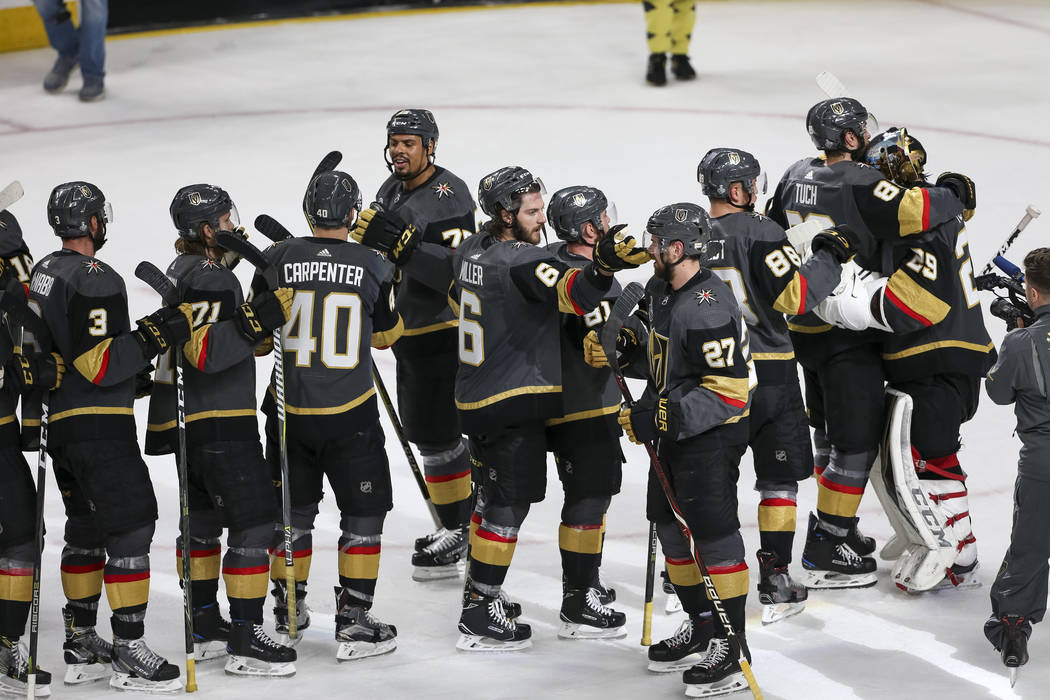The Vegas Golden Knights celebrate their 6-4 win over the Washington Capitals in Game 1 of the NHL hockey Stanley Cup Finals at T-Mobile Arena in Las Vegas on Monday, May 28, 2018. Richard Brian L ...