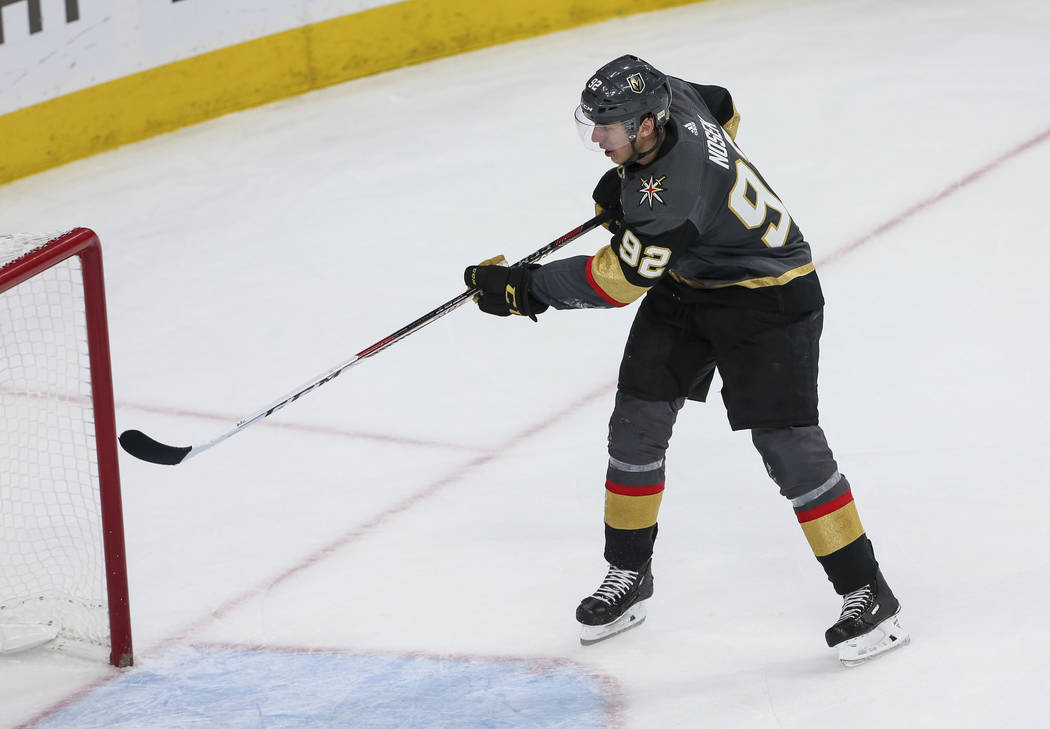Vegas Golden Knights left wing Tomas Nosek (92) scores an open net goal against the Washington Capitals during the third period in Game 1 of the NHL hockey Stanley Cup Finals at T-Mobile Arena in ...