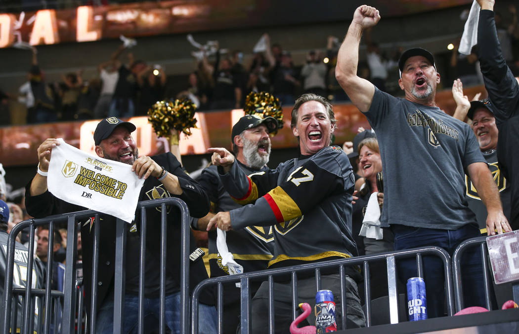 Golden Knights fans celebrate a goal by Golden Knights defenseman Colin Miller, not pictured, during the first period of Game 1 of the NHL hockey Stanley Cup Final against the Washington Capitals ...