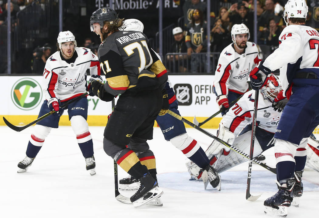 Golden Knights center William Karlsson (71) celebrates a goal against Washington Capitals goaltender Braden Holtby (70) during the first period of Game 1 of the NHL hockey Stanley Cup Final at the ...