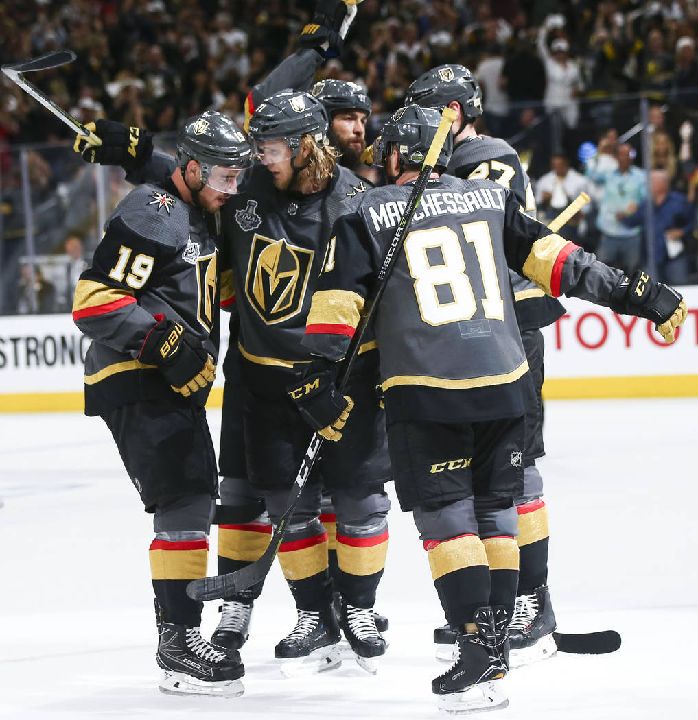 Golden Knights players celebrate a goal by Golden Knights center William Karlsson, second from left, against the Washington Capitals during the first period of Game 1 of the NHL hockey Stanley Cup ...