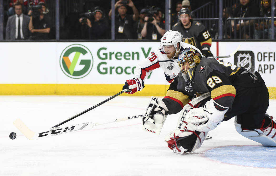Golden Knights goaltender Marc-Andre Fleury (29) defends as Washington Capitals center Lars Eller (20) tries to get the puck during the second period of Game 1 of the NHL hockey Stanley Cup Final ...